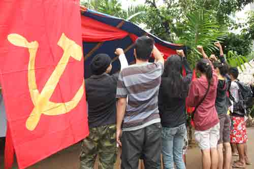 Youth groups give tribute to fallen red fighters and cadres during the commemoration of 46th year of CPP. PHOTO BY BASILIO RAMOS / BICOLTODAY.COM - See more at: http://bicoltoday.com/2014/12/26/in-photos-cpp-turns-46-the-cpp-led-philippine-revolution-strong-at-46-winning-more-recruits-as-crises-worsen/#sthash.0PraI48S.dpuf