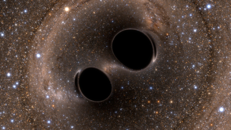 Hình ảnh computer mô phỏng hai hố đen quay cạnh nhau trước khi hòa nhập thành một