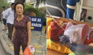 Mẹ bệnh nhi khóc lóc khi bảo vệ không cho xe cấp cứu ra khỏi viện.