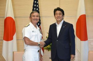 Admiral Harry B. Harris Jr, (L), Commander of United States Pacific Command, is welcomed by Japanese Prime Minister Shinzo Abe (R) during a courtesy call at Abe's official residence in Tokyo on July 26, 2016 (AFP Photo/Toru Yamanaka)