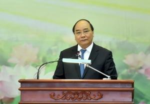 Thủ tướng Phúc nói chuyện tại hội nghị liên viện. Ảnh: VNE